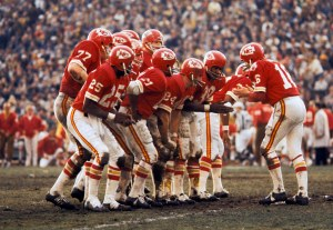 "I love the ""Choir Huddle"" used by the Super Chiefs, and I've used several different photos of it in my books. This is a shot from Super Bowl IV."